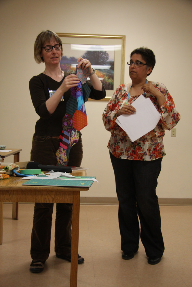 Paula and Arita demonstrating hexagons