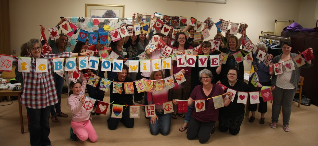 Vancouver Modern Quilt Guild members with their flags, photo by Stacey Day