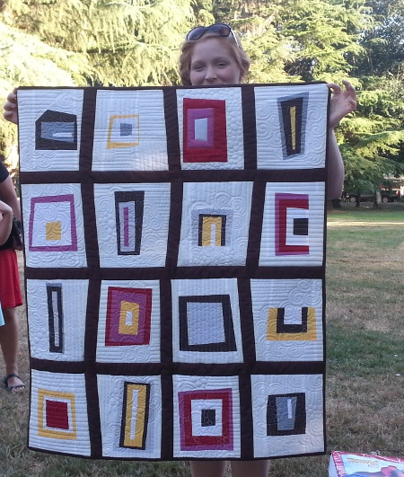 Samantha with baby quilt, photo by Holly Broadland